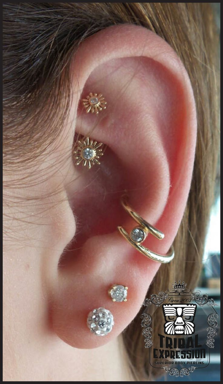 Beautiful conch and rook piercing combo!
