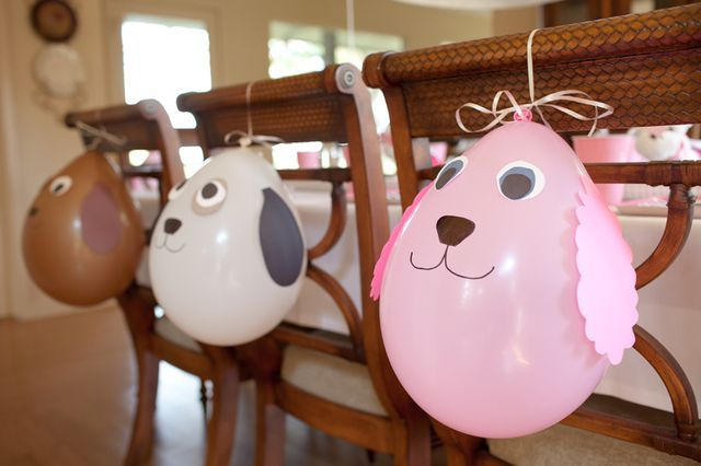 Balloons at a each chair at a Puppy party