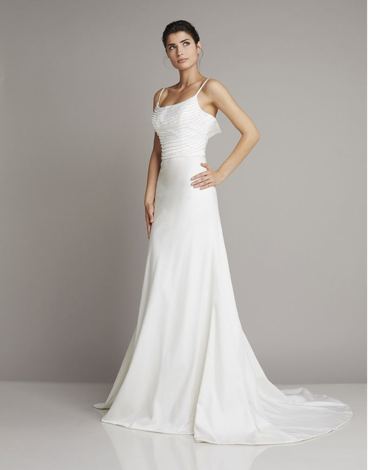 Slim Straight wedding dress of silk with spaghetti straps and beautiful details at the top of Giuseppe Papini
