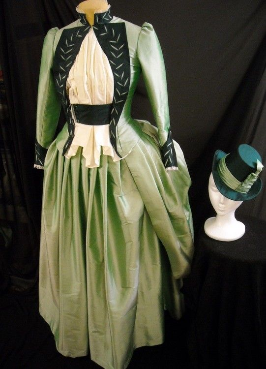 Victorian Walking Dress Green Silk Mina Bustle Gown and Hat front, via Etsy.