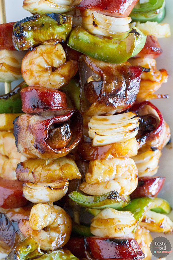Heat that grill up for these Grilled Shrimp and Sausage Kabobs - with lots of veggies, sausage, shrimp and bacon, all covered in a sticky sweet glaze.