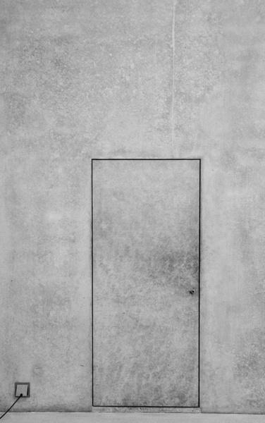 concrete door in concrete wall