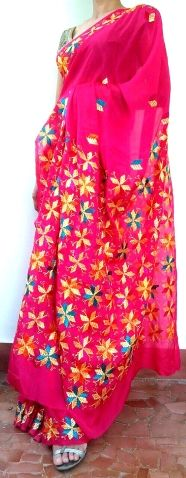 This gorgeous chinon chiffon phulkari saree is hand-embroidered in the phulkari/bagh work style. The pallu has heavy, intricate embroidery, with a border running throughout the sari and small motifs at intervals. - See more at: http://giftpiper.com/Handembroidered-Chinon-Chiffon-Phulkari-Saree-DarkPink-id-870273.html