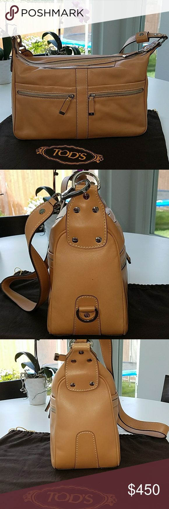 """TOD'S Leather Purse Stunning in MINT shape! Natural color leather Tod's bag. Perfect summer color! Used twice!!!  4 outside Pockets 2 with zippers and 2 on the backside are open pockets. Strap can be worn short/long. Bag has a 21"""" drop when strap is at full extension, & apx. a 10"""" drop when it's at the short hang. Can be worn as a shoulder bag/cross body. Bag has one inside zipper compartment. All zippers have leather pulls.  Bag measures 13"""" long,   approximately 9 1/2"""" High & just over 5""""…"""