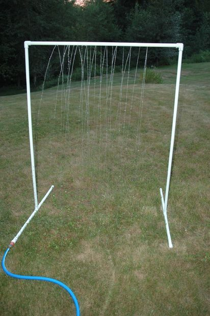 """PVC Sprinkler Water Toy - how smart is this? $10 worth of materials from the hardware store will bring lots of joy this summer. :) My friend did this with her kids and used a couple of pipes and plastic streamers as well, they called it a """"car wash"""" and rode their bikes through it. They played with it all summer."""