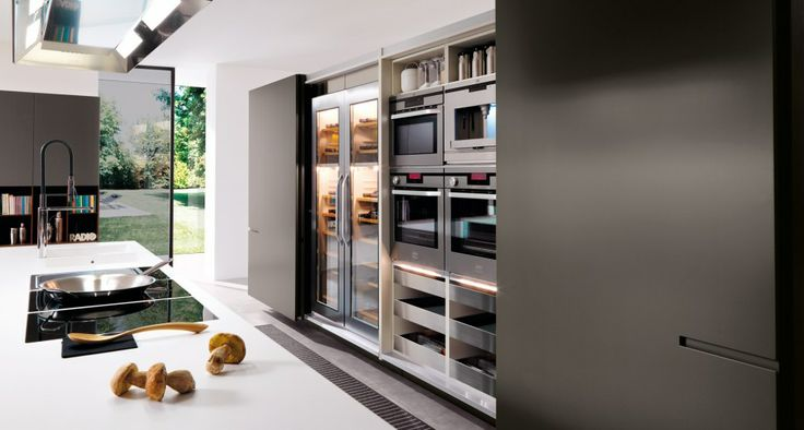 Unique Flexy M35 opening doors on a double column linear from 243.6 cm. Inside compartment with ovens, functional Full extension drawers with stainless steel accessories wood Fineline and LED light.