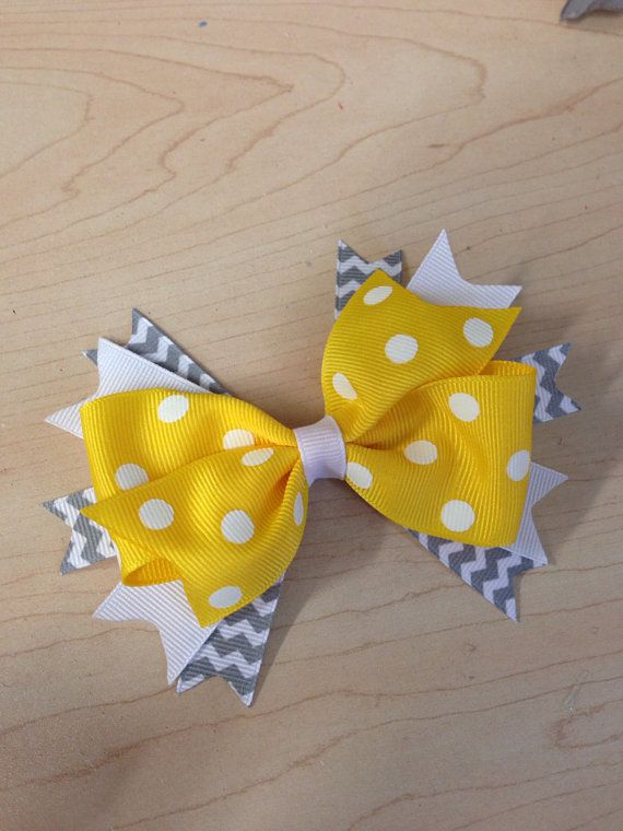 Yellow polka dot with grey and white chevron hair bow on Etsy, $7.00