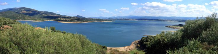 Lake Coghinas (Italian: Lago di Coghinas) is an artificial lake, in northern Sardinia, Italy, located between the provinces of Sassari and Olbia-Tempio. With a surface of 17.8 km² and a capacity of 254 millions cubic metres of water, it is the second largest lake in the region (second only to Lake Omodeo) and one of the major reservoirs in Italy. Wikipedia