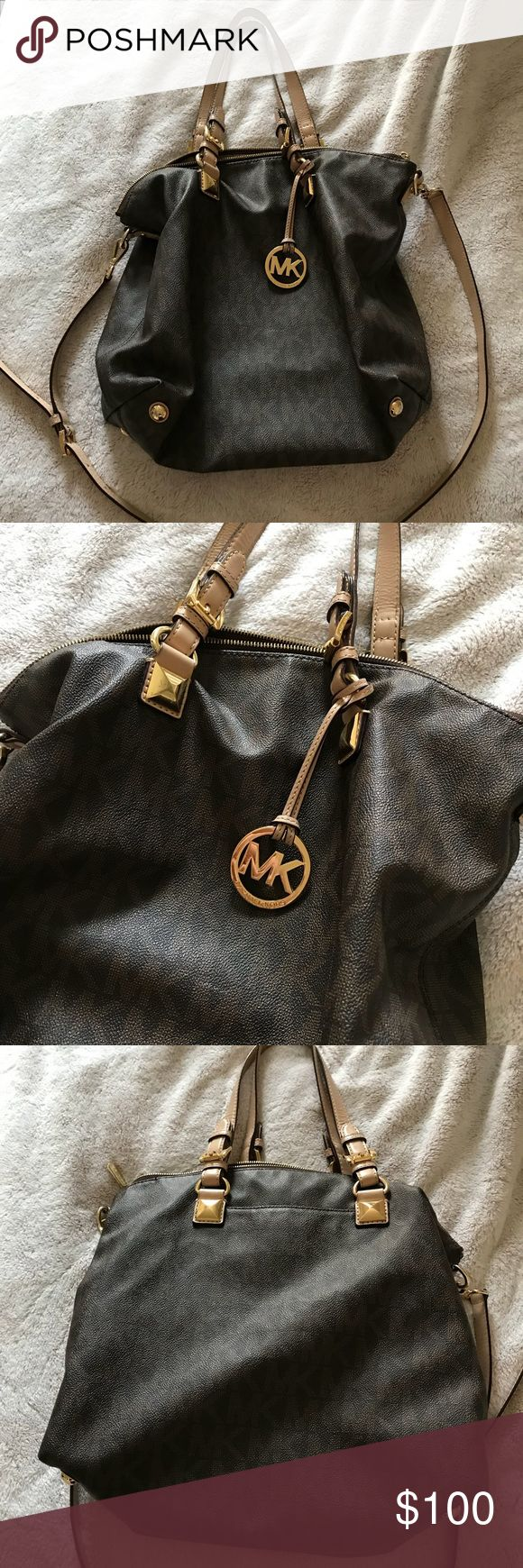 MK tote Worn MK TOTE, has a lot of use left, some of the gold hardware has scratches on them but barely noticeable, and the inside of the bag has a couple of marks but barely noticeable as well! price reflects current condition! Otherwise good condition! Michael Kors Bags Totes