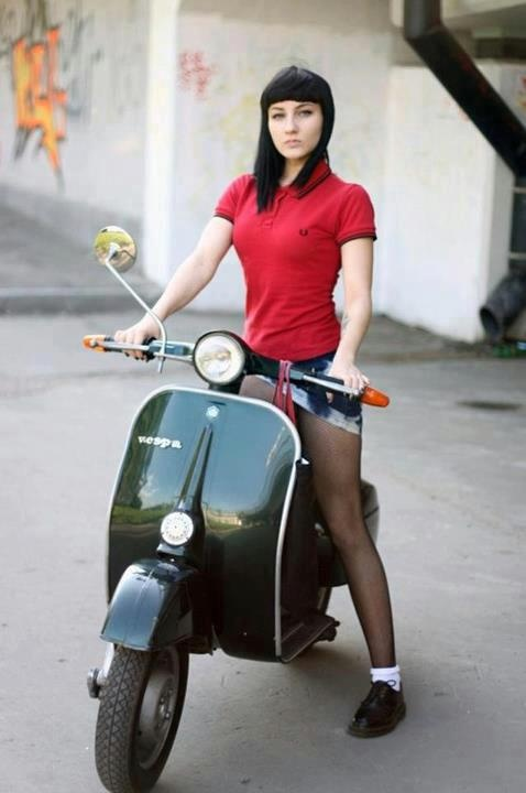 "skinhead girl, on a scooter. Even females are part of the ska and skinhead subculture.One of the most famous ska songs is Symarip's ""Skinhead Girl,"" and numerous other classic ska songs reference skinheads. Italian scooters were a common mode of transportation favored by the early mods and skinheads."