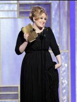 An emotional Adele thanks her new born son as she accepts the Golden Globe for Best Original Song for 'Skyfall.'