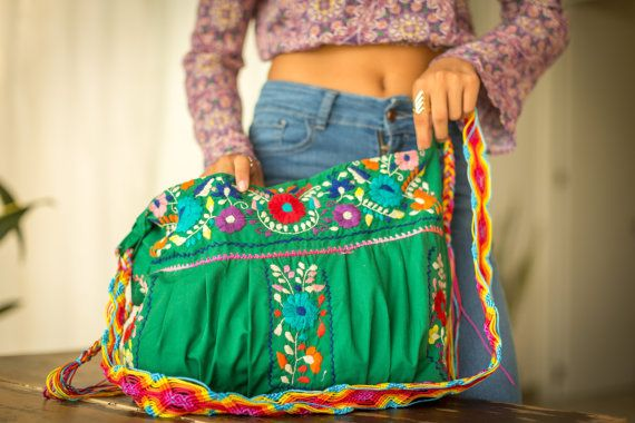 Mexican Embroidered Cross Body Purse with Macrame strap in kelly green and FREE SHIPPING The Bonita Lolita not only encompasses the genuine traditions of Central Mexican hand embroidery techniques, also incorporates a super colorful, hand woven, indigenous made belt from the Chiapas region of Mexico. This bright , vibrant, medium sized bag is embellished with hand stitched flowers in different floral shapes and sizes. All in an array of stunning fuchsia, turquoise, red, orange, and green…