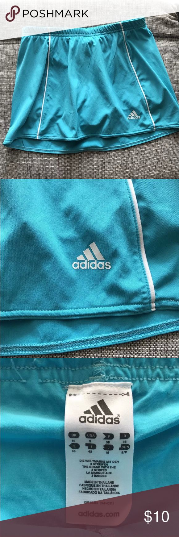 Adidas short skirt blue color tennis Sporty This is a colorful Pre-loved skirt with no visible stains or rips. This skirt is clean and ready to wear.   For measurement look at the pictures.   If any question, please, let me know. adidas Skirts Mini