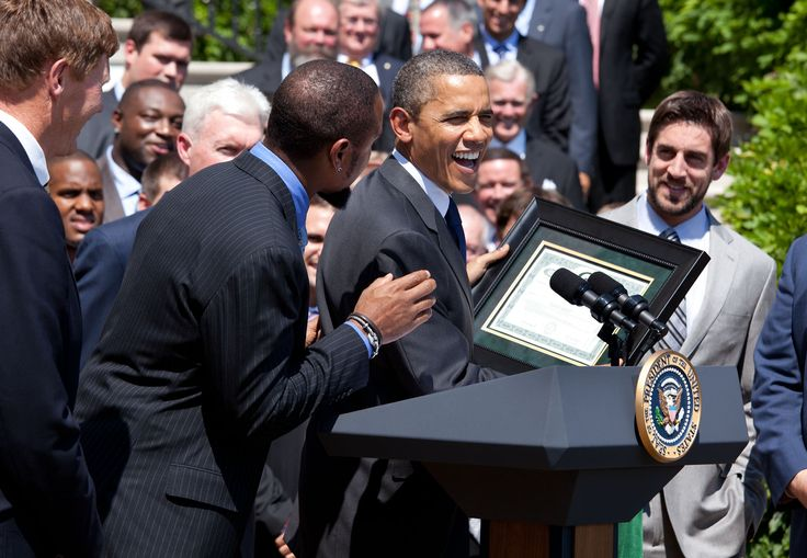 2010 Super Bowl Champion Green Bay Packers at the White House with President Barrack Obama. Aaron Rodgers looking on.