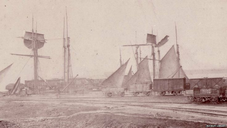Boats and railway carriages on the dock at Connah's Quay port, A railway once served the dock at Connah's Quay port, helping to transport produce such as that made at Buckley's former brickworks - date unknown