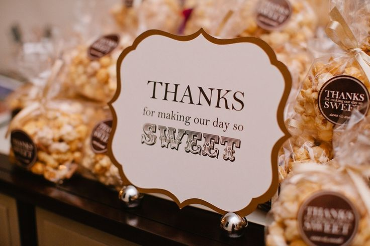 Thanks for making our day so sweet popcorn favor wedding popcorn station popcorn bags with custom stickers wedding favors - Photo by Anna Routh Photography