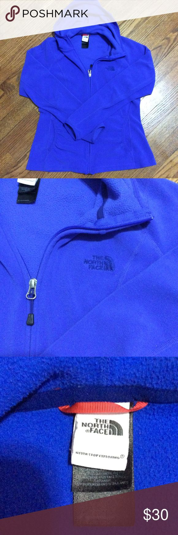"""The North Face 100 Masonic Hoodie A warm feminine cut Polartec Classic fleece hoodie that's warm at every layer...the 100 Masonic Hoodie has a full zip closure, thermally efficient, quick drying and 2 front gathered pockets. Resists pilling, fading and maintains shape but does have some stretch. Beautiful royal blue. P-P 18"""" S-H 22"""" Sleeve 23"""" The North Face Jackets & Coats"""
