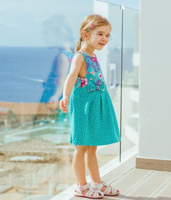 Our sleeveless HILLE dress is fully lined and features sweet box pleats and a zipper down the back of the dress. The cut is roomy for active kids. If your child is especially thin, consider sewing a size lower than usual, while keeping the length of their usual size in the pattern.  Sew the bodice and skirt in the same fabric, or use a contrasting fabric to add even more personality! The pattern offers a pretty bow, too.  Depending on your choice of fabric, HILLE can be worn the entire year.