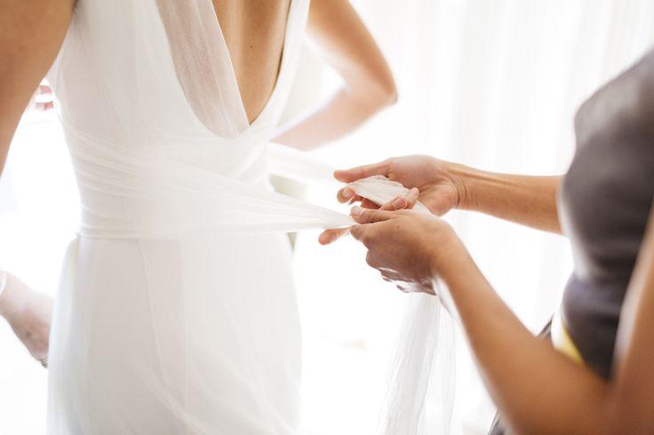 Final touches... wedding dress by #Cortana #realbrides #WeddingDresses