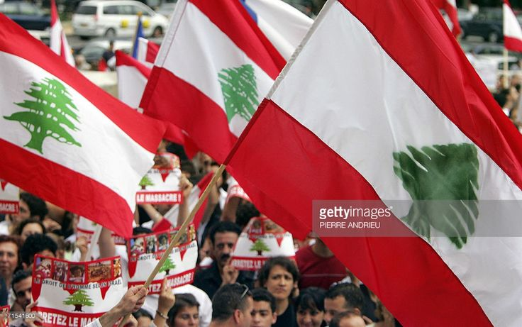 Lebanese national flags are seen during a demonstration to denounce the Israeli attacks in Lebanon, 30 July 2006 in Paris.The United Nations Security Council opened an emergency meeting today on the Lebanon crisis, as France circulated a draft resolution for an ceasefire in the conflict. UN Secretary General Kofi Annan appealed to the council to call for an immediate ceasefire in the Mideast conflict as he condemned Israel's bombing of the Lebanese town of Qana, which killed over 50…