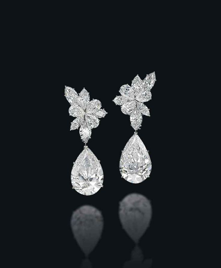 A pair of diamond earrings, by Harry Winston #christiesjewels