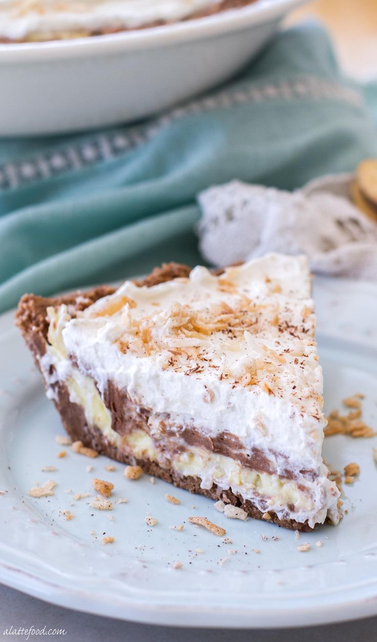 This easy, no-bake chocolate coconut cream pie recipe is the perfect summer dessert! Whipped cream, chocolate cream, and coconut cream are layered on top of a Keebler cookie crust! It's glorious.