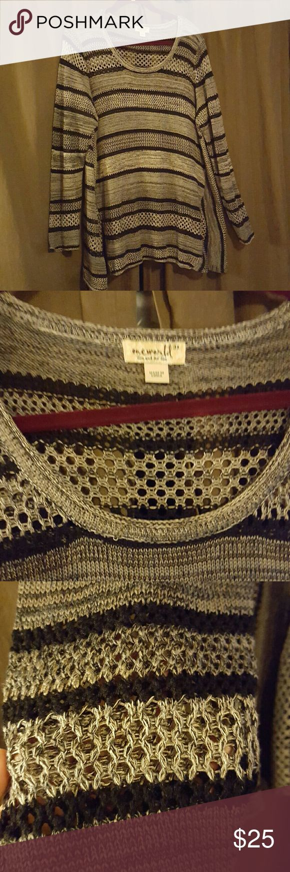 One World plus sz. 3X loose knit sweater This is a cute long sleeve loose knit sweater from one world. It is black and grey striped. It is a plus size 3x and is true to size. It has a shark bite hem and is in great condition ONE WORLD Sweaters