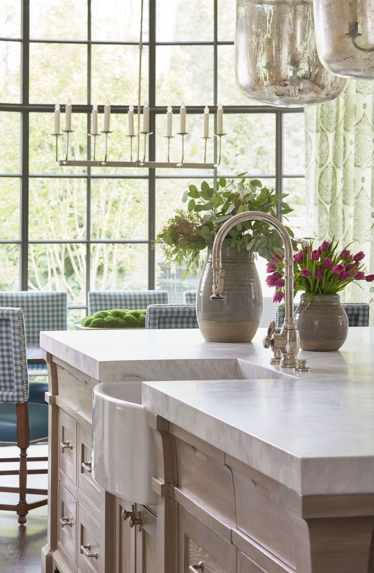 Farm sink with thick marble countertop Breakfast chairs upholstered in check  Kitchen  Breakfast Room  Design Detail  TraditionalNeoclassical  Transitional by Lauren DeLoach Interiors