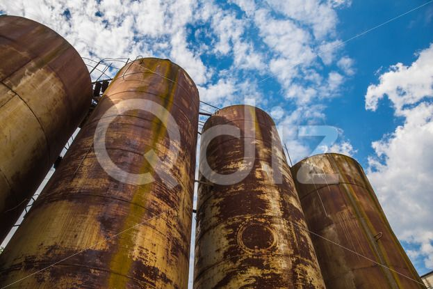Qdiz Stock Photos | Rusty tanks,  #abandoned #big #blue #container #deserted #factory #ferruginous #fuel #high #industrial #industry #manufacturing #metal #modern #oil #old #outdoors #production #refinery #reflection #reservoir #round #rusty #silo #sky #stainless #steel #storage #tall #tank #technology #tube