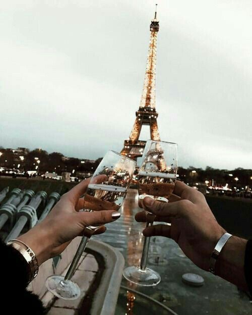 Cheers to this stunning view! Even on a rainy day Paris does not disappoint!