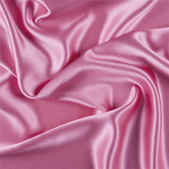 MATERIAL : 100% Silk BRAND : Fashion Fabrics Club COLOR : Pink FIBER CONTENT : 100% Silk CALIFORNIA PROP 65 WARNING : FalseFashion Fabrics ClubHot Pink Silk Crepe Back SatinSolid Hot Pink Silk Crepe Back Satin Fabric Top of the line silk with a high sheen, similar to charmeuse only heavier and more luxurious. Top side is shiny back side which is crepe has a fine rib and pebble look and feel. Both sides can be used for textural effects. A superb choice for bridal or the most elegant evening wear.