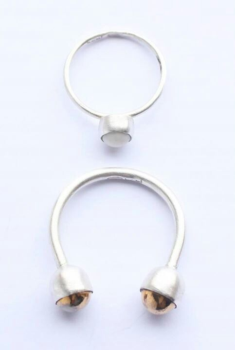 Top: Little White One, clear glazed porcelain gem, plain bezel flat setting, 100% recycled silver. Below: Double Gold Open Ring, 2 gold lustre glazed porcelain gems, plain bezel cup setting, 100% recycled silver. Liv Thrane Jewellery. www.facebook.com/livthranejewellery & www.livthrane.com