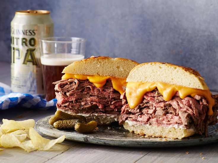 Roast Beef and Cheddar Sandwich with Horseradish Sauce | We are not thinkin' Arbys-- not after a roast beef sandich like this one. A classic creamy cheese sauce makes this sandwich super rich, while a horseradish sauce adds a kick. We love the onion bun, preferably bakery-made, but you could also use a pretzel bun instead. Make this sandwich the centerpiece of your Super Bowl Spread or serve along with beer and fries for a crowd-pleasing meal.