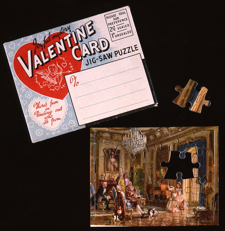 'My dear Valentine' Valentine Card. Valentine card jigsaw puzzle in unused envelope decorated with large red heart enclosing Cupid shooting his arrow. Puzzle is coloured card depicting a lady playing harpsichord to suitors. Verse reads 'My dear Valentine unto thee my thoughts do fly/ Until with bitter pain I cry/ Cry aloud for thee and yet, no nearer do I come to thee'. c.1930 (OB1996.87)