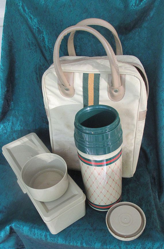 1970s Aladdin thermos and sandwich box,near mint condition-thermos has a nautical/anchor theme on sides. Great for picnics, Selling price is for thermos and box,Tote goes with them,but has some stains and surface bubbles,inside is clean and zipper works Please read shop policies