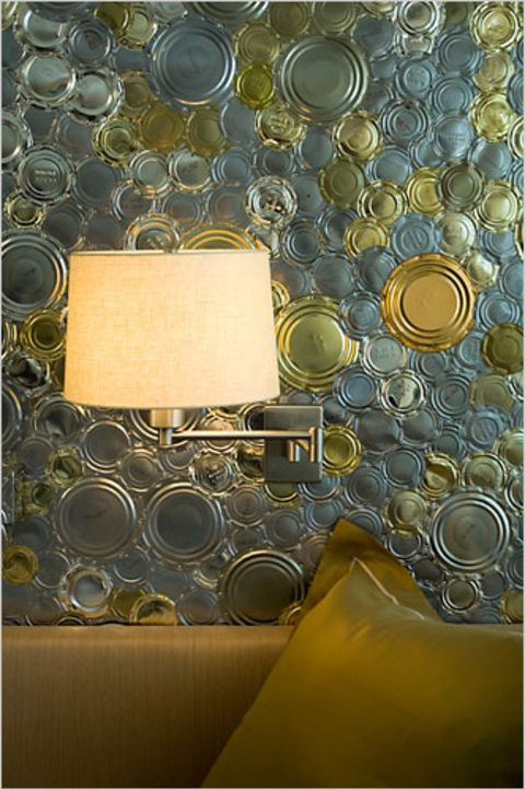 Tin Can Wallpaper: Wel, more like wall-tin... bu what an unforgettable affect! This takes recycling to a whole other planet, but goes a long way in communicating how we can save ours. Tip: Create this same feel on a smaller level. Cut out cans and glue them to a cardboard piece and frame it. Photo Courtesy of Kathyremodlingblog.com via nytimes.com.