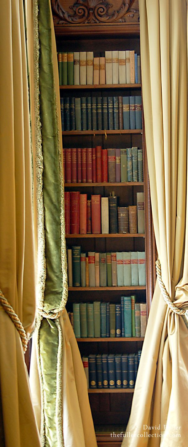 Pay no attention to the man behind the curtain, or in this case the books! This bookshelf is artfully accented by the addition of yellow & green curtains.