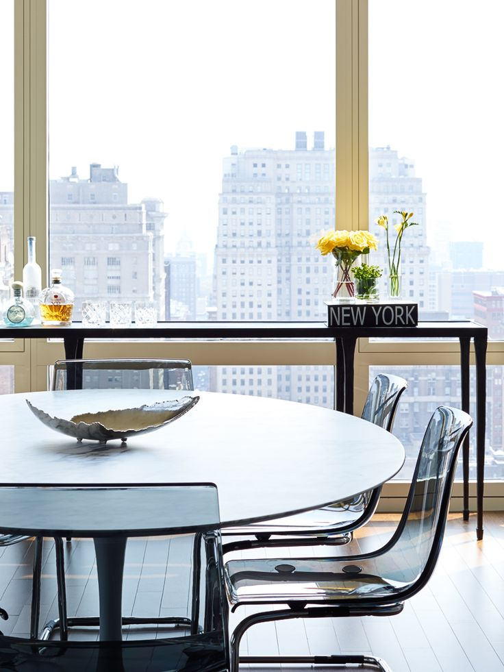 large marble oval saarinen dining table with plexi chairs long console doubles as bar city. Black Bedroom Furniture Sets. Home Design Ideas