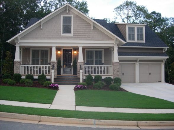 really like this house... maybe with some color, green with dark wood beams and cobblestone... but love the design. ~ j.