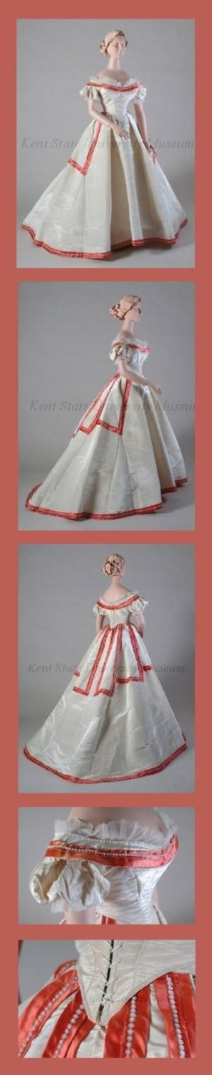 Dress, ca 1865, American or European. Ivory watered silk evening dress. Bodice with round neck, rimmed with red satin band, seed pearls curled with crystal beads, edged with pleated tails, puffed cap sleeves edged with pleated toile, laced up back, skirt:circular with train, attached peplum trimmed with red satin band, seed pearls, crystal beads. by jenniferET