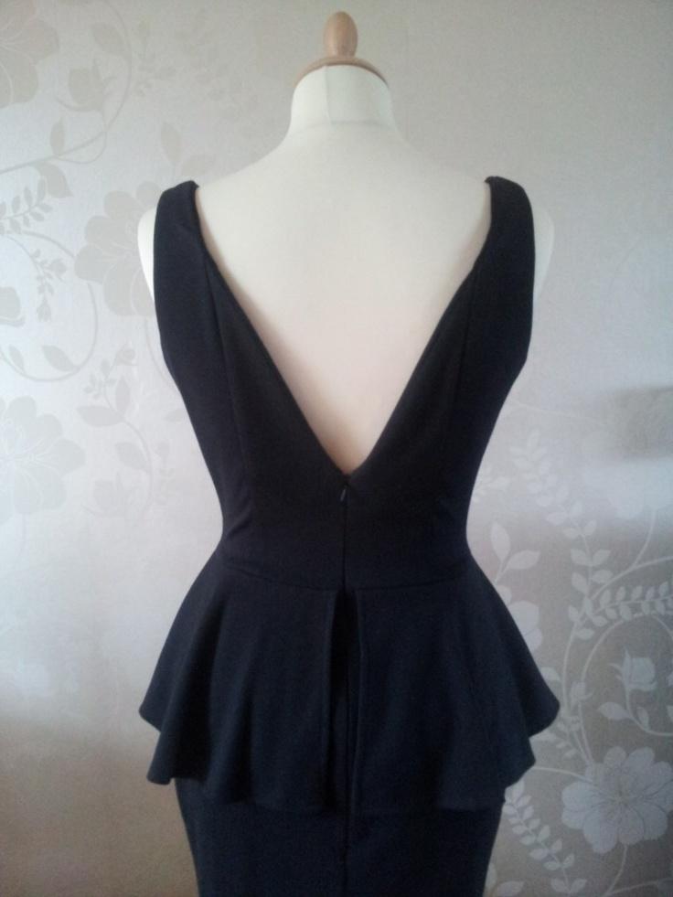 Jersey peplum dress with backless detail