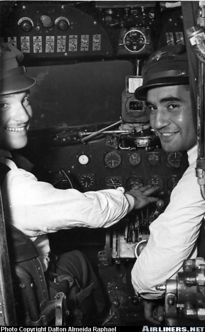 Real Aerovias PP-YRO Douglas C-54A-DC (DC-4) - Capt. Dalton (right side) checking another captain at CGH