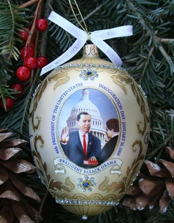 The ornament features an original painting depicting President Barack Obama being administered the Presidential Oath of Office with the Bible that Abraham Lincoln used when he took the Oath of Office. Description from examiner.com. I searched for this on bing.com/images