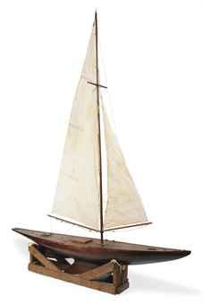 A LARGE CARVED WOOD POND YACHT