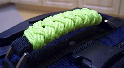 16 lead 3 bight Turk's head knot on luggage handle... way better than our frayed curled wrapping ribbons  : )