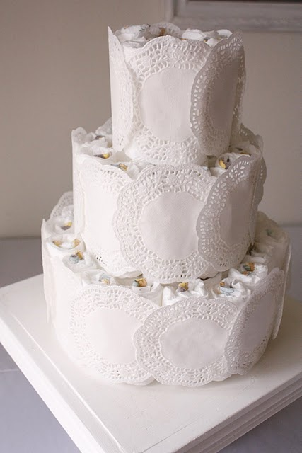 Diaper Cake wrapped in doilies. Great for a baby shower.