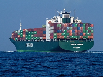 Container ship loaded to the gills.