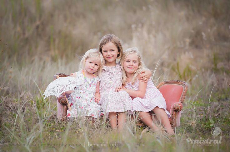 Three beautiful sisters..... New Zealand kids at Long Bay Beach.... www.facebook.com/mistralphoto
