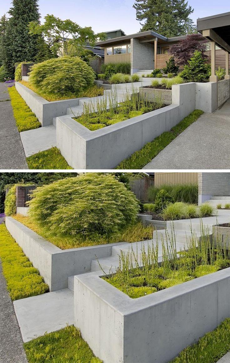 aménagement de jardin contemporain avec des parterres surélevés en béton