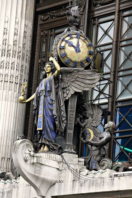 "The Queen of Time is the clock over the entrance to Selfridges flagship store on Oxford Street, London, England. The clock was installed in 1931 and supports an Elizabethan ship, recalled the early days of the exploration that would lead to the industrial revolution, trade and commerce. Selfridge once said "" I am prepared to sell anything from an aeroplane to a cigar."